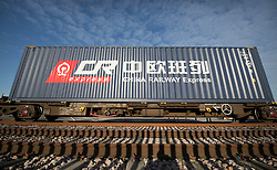 CAPTION CORRECTION © Licensed to London News Pictures. 18/01/2017. London, UK.  A container waits to be unloaded from the first direct rail freight train from China at Barking Rail Freight Terminal east of London. The new service set off from China on the 3rd of January this year. London is now the 15th European city to join what the Chinese government calls the New Silk Route. Photo credit: Peter Macdiarmid/LNP
