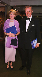 The DUKE & DUCHESS OF ROXBURGHE at a dinner in London on 19th May 1999.MSF 40