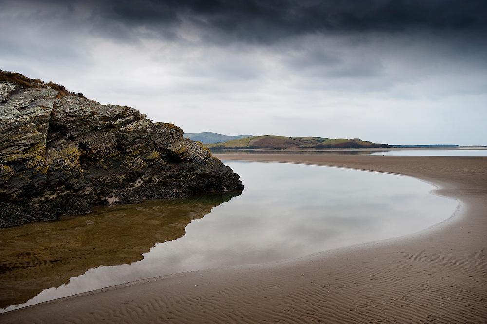 Low tide at the mouth of the Afon Dwyryd (River Dwyryd) on Portmeirion estate, Gwynedd, North Wales, UK.