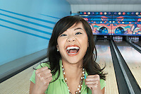 Young Woman Celebrating Bowling Score