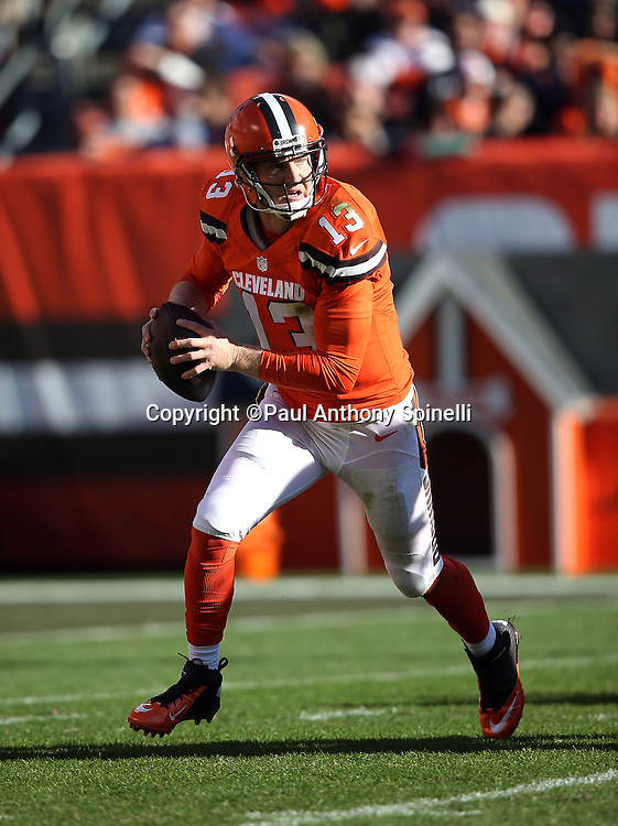 Cleveland Browns quarterback Josh McCown (13) rolls out while looking to pass during the 2015 week 8 regular season NFL football game against the Arizona Cardinals on Sunday, Nov. 1, 2015 in Cleveland. The Cardinals won the game 34-20. (©Paul Anthony Spinelli)