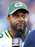 Green Bay Packers wide receiver Randall Cobb (18) is interviewed about the fact that the game was canceled before the 2016 NFL Pro Football Hall of Fame preseason football game against the Indianapolis Colts on Sunday, Aug. 7, 2016 in Canton, Ohio. The game was canceled for player safety reasons due to the condition of the paint on the turf field. (©Paul Anthony Spinelli)