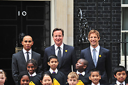 © licensed to London News Pictures. London, UK  11/05/11 Lewis Hamilton and Jenson Button meet with prime minister David Cameron in Downing Street London to Launch a new road safety campaign  . Please see special instructions for usage rates. Photo credit should read AlanRoxborough/LNP