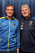 AFC Wimbledon manager Glyn Hodges with 12th man (spnsor) during the EFL Sky Bet League 1 match between AFC Wimbledon and Gillingham at the Cherry Red Records Stadium, Kingston, England on 23 November 2019.