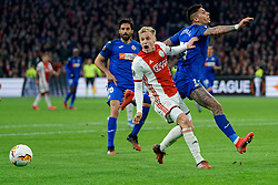 Donny van de Beek #6 of Ajax and Mathías Olivera #17 of Getafe in action during the Europa League match R32 second leg between Ajax and Getafe at Johan Cruyff Arena on February 27, 2020 in Amsterdam, Netherlands