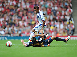 Corentin Tolisso of Lyon battles for the ball with Olivier Giroud of Arsenal  - Mandatory by-line: Joe Meredith/JMP - 25/07/2015 - SPORT - FOOTBALL - London,England - Emirates Stadium - Arsenal v Lyon - Emirates Cup