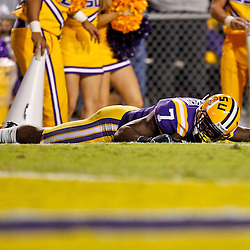 November 13, 2010; Baton Rouge, LA, USA; LSU Tigers cornerback Patrick Peterson (7) lays on the ground after returning an interception 85-yards before being knocked out of bound during the first half against the Louisiana Monroe Warhawks at Tiger Stadium.  Mandatory Credit: Derick E. Hingle