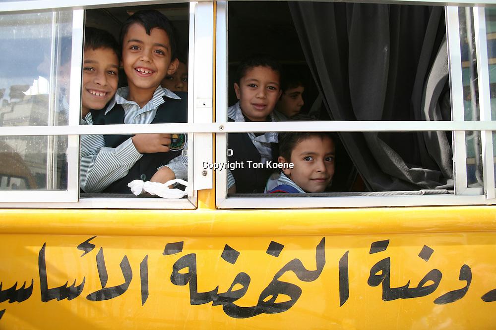 Children on a school bus in Amman, Jordan