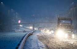 © Licensed to London News Pictures. 10/12/2017. Bourne End, UK. Stand still traffic at the scene of an incident on the A41 near Bourne End in Buckinghamshire where vehicles have spun on the road in heavy snow. The A41 north bound is currently closed. Parts of the south east of England are blanketed with snow for the first time this winter. Photo credit: Ben Cawthra/LNP