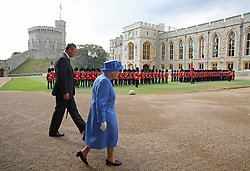 Queen Elizabeth II and Lieutenant Colonel Sir Andrew Ford walk in the Quadrangle at Windsor Castle, Windsor ahead of a ceremonial welcome for US President Donald Trump.