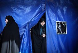 Voters leaves after casting their ballots at a polling station in the city of Qom, Iran, on Feb. 26, 2016. Elections for Iran's parliament (Majlis) and Assembly of Experts kicked off at 8 a.m. local time (0430 GMT) on Friday. EXPA Pictures © 2016, PhotoCredit: EXPA/ Photoshot/ Ahmad Halabisaz<br />
