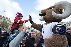 © licensed to London News Pictures. London, UK 27/10/2012. Brandon Baker, 4, high-fiving a St Louis Rams mascot at NFL Fan Rally in Trafalgar Square ahead of this weekend's NFL games at Wembley Stadium between the New England Patriots and the St Louis Rams. Photo credit: Tolga Akmen/LNP