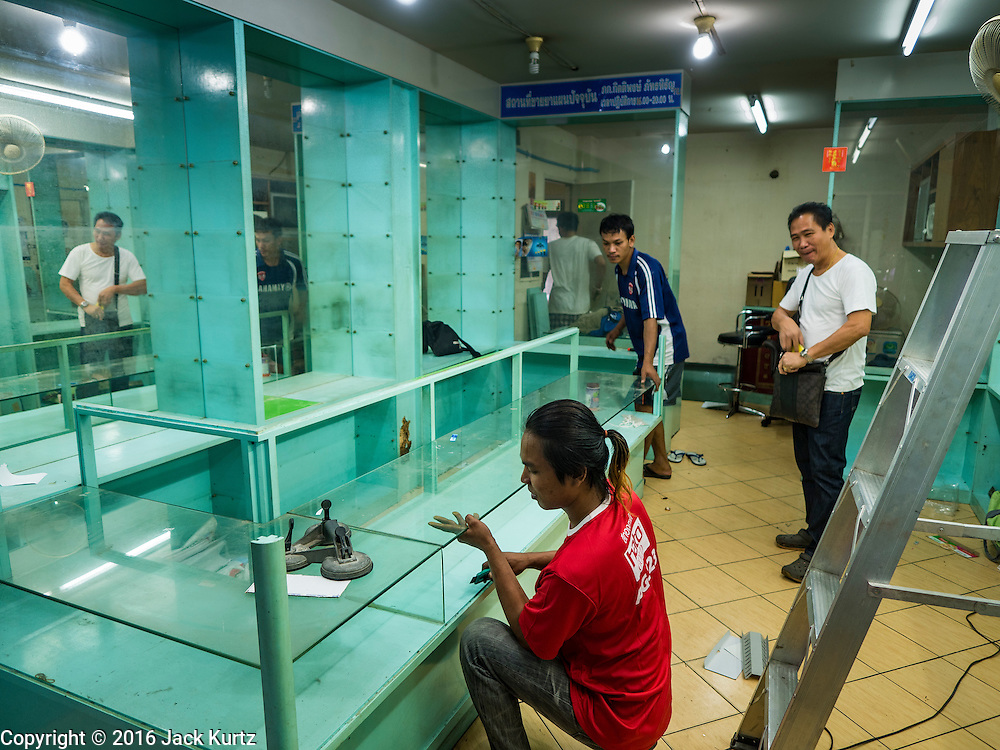 05 JANUARY 2016 - BANGKOK, THAILAND:          Workers take apart an abandoned jewelry store in the closed Bang Chak Market. The market closed permanently on January 4, 2016. The Bang Chak Market served the community around Sois 91-97 on Sukhumvit Road in the Bangkok suburbs. Bangkok city authorities put up notices in late November that the market would be closed by January 1, 2016 and redevelopment would start shortly after that. Market vendors said condominiums are being built on the land.                   PHOTO BY JACK KURTZ