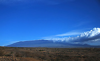 Hawaii, South Pacific, Mauna Kea.  Rugged landscape with hills rising in the distance.