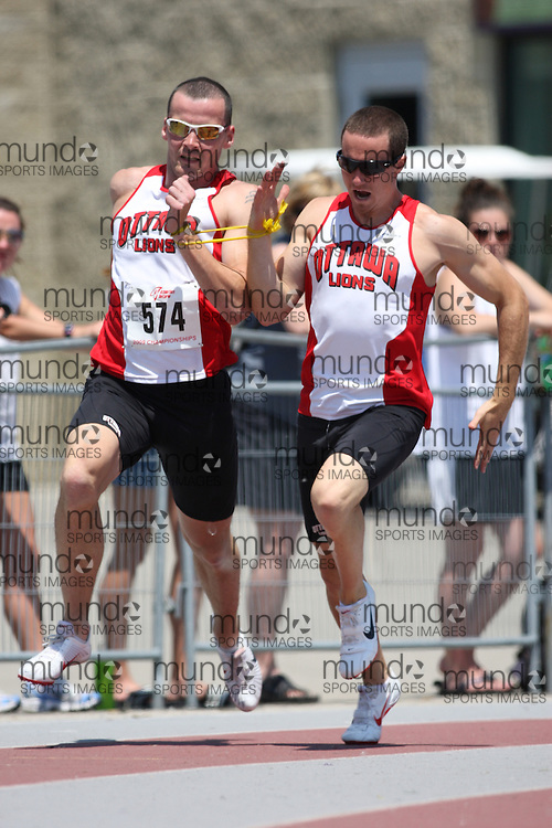 (London, Ontario---14/06/09)   Jon Dunkerley of Ottawa Lions T.F.C. competes in the  200m at the 2009 Athletics Ontario Junior Track and Field Championships. The meet was held in London, Ontario from June 13-14, 2009. Copyright photograph Sean Burges / Mundo Sport Images, 2009. www.mundosportimages.com / www.msievents.