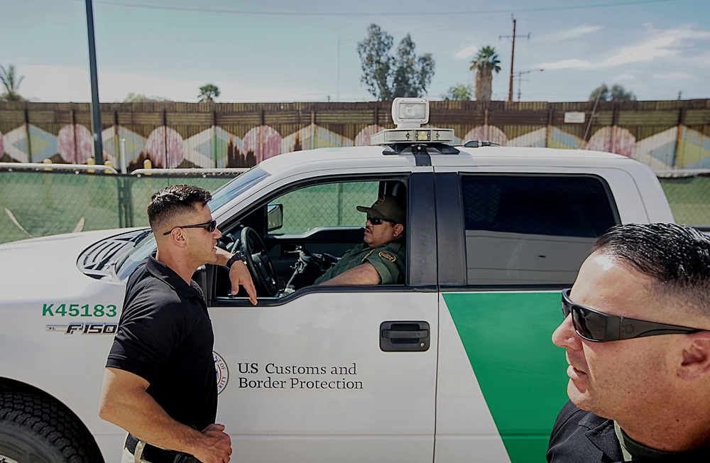 Border Patrol agents along the border fence on Friday, April 6, 2018 in Calexico, California.  President Doanld Trump is sending National Guard to the border in an attempt to stop the flow of illegal immigrants crossing over.