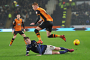 Bolton Wanderers midfielder Josh Vela makes sliding tackel on Hull City midfielder Sam Clucas during the Sky Bet Championship match between Hull City and Bolton Wanderers at the KC Stadium, Kingston upon Hull, England on 12 December 2015. Photo by Ian Lyall.