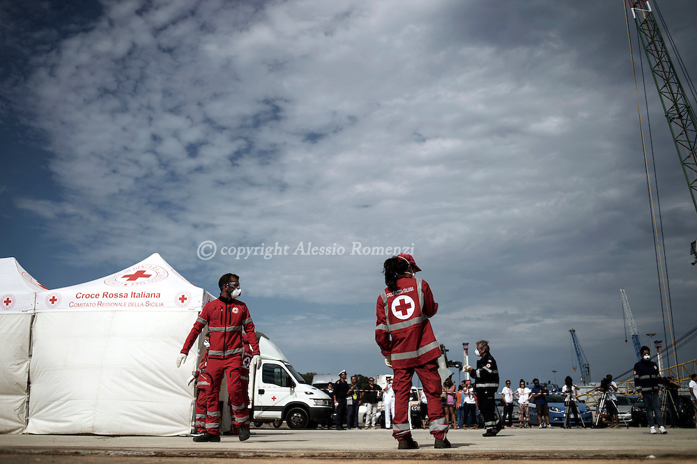 Italy: MSF Dignity1: Italian Red Cross members get ready to receive migrants rescued at sea on the deck of the Augusta port on August 25, 2015. Alessio Romenzi