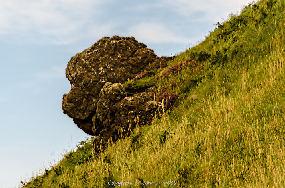 This is a natural rock sticking out from a hillside on the way down to the Giants Causeway in County Antrim, Northern Ireland.  To me this rock looks like a Chinese lion's head.   Can you see it?