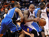 Dec. 09, 2012; Phoenix, AZ, USA; Phoenix Suns guard Shannon Brown (26) handles the ball during the game against the Orlando Magic guard Arron Afflalo (4) in the second half at US Airways Center. The Magic defeated the Suns 98-90. Mandatory Credit: Jennifer Stewart-USA TODAY Sports