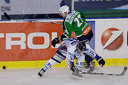 Tomi Mustonen (HDD Tilia Olimpija, #21) vs Daniel Fekete (Sapa Fehervar AV19, #91) during ice-hockey match between HD Tilia Olimpija and HK Acroni Jesenice  in 6th Round of EBEL league, on October 3, 2010 at Hala Tivoli, Ljubljana, Slovenia. (Photo By Matic Klansek Velej / Sportida.com)