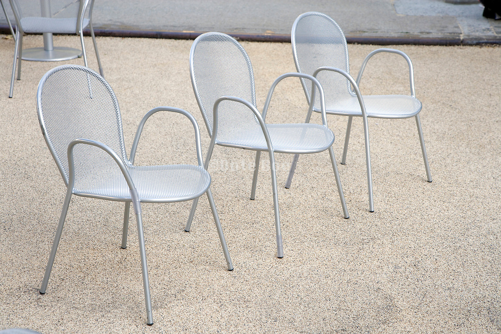 3 outdoor chairs in a row