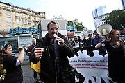 Frankfurt am Main | 20 Jun 2015<br /> <br /> Kundgebung der islamfeindlichen Gruppe &quot;Widerstand Ost West&quot; (WOW) um Ester Seitz, die Rechtspopulisten, rechte Hooligans und Neonazis vereint, auf dem Rossmarkt.<br /> Hier: Der Rechtspopulist Michael St&uuml;rzenberger h&auml;lt eine Rede.<br /> <br /> Photo &copy; peter-juelich.com