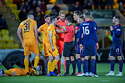 Goalkeeper Zdenek Zlamal (#1) of Heart of Midlothian and his team mates surround referee Nick Walsh after he gives Livingston a penalty and during the Ladbrokes Scottish Premiership match between Livingston FC and Heart of Midlothian FC at the Tony Macaroni Arena, Livingston, Scotland on 14 December 2018.
