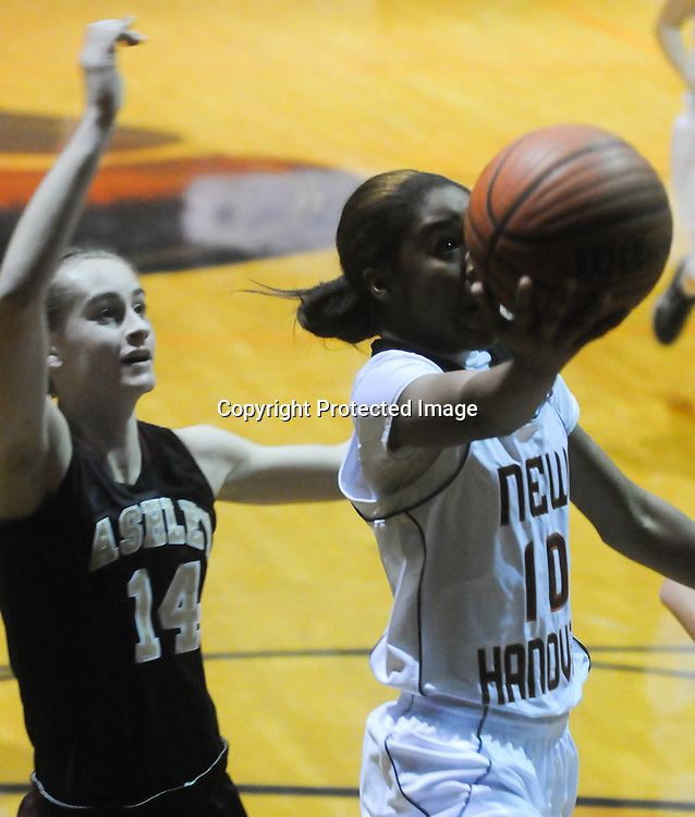 New Hanover's Taylor Perkins shoots over Ashley's Carly Higgins Friday December 19, 2014 at New Hanover High School in Wilmington, N.C. (Jason A. Frizzelle)
