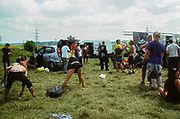 Ravers take the party outdoors, Avonmouth, Bristol, UK, June 2014