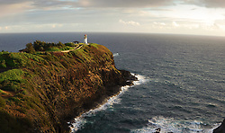 DIGITAL PANORAMA COMPOSITED IMAGE -Sunrise on the Kilauea Point Lighthouse located on the northernmost point of the main Hawaiian islands on the island of Kauai. The lighthouse, built in 1913 as a navigational aid for commercial shipping between Hawaii and the Orient was deactivated in 1976 and replaced with an automated beacon for local boaters and aircraft. The Kilauea Point Lighthouse is part of the U.S. Fish and Wildlife Service Kilauea Point National Wildlife Refuge. The refuge is home to the largest populations of nesting seabirds in Hawaii including red-footed boobies, Laysan albatrosses, wedge-tailed shearwaters which nest along the ocean cliffs and open grassy slopes of Crater Hill, an extinct volcano.