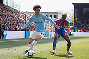 Manchester City midfielder Leroy Sane (19) and Crystal Palace defender Aaron Wan-Bissaka (29) during the Premier League match between Crystal Palace and Manchester City at Selhurst Park, London, England on 14 April 2019.