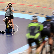 A group of cyclists race past photographers at the LA Velodrome Sports Center in Carson, CA on Thursday, April 26, 2018. Photo by Trevor Stamp / Sports Shooter Academy