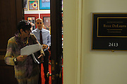 United States Congresswoman Rosa DeLauro, 69, a Democrat representing Connecticut's Third district. She is currently in her eleventh term, having been in Congress for twenty one years...Delauro dashing off from her office to Congress for a vote. Her aides run along with her briefing her on the issues