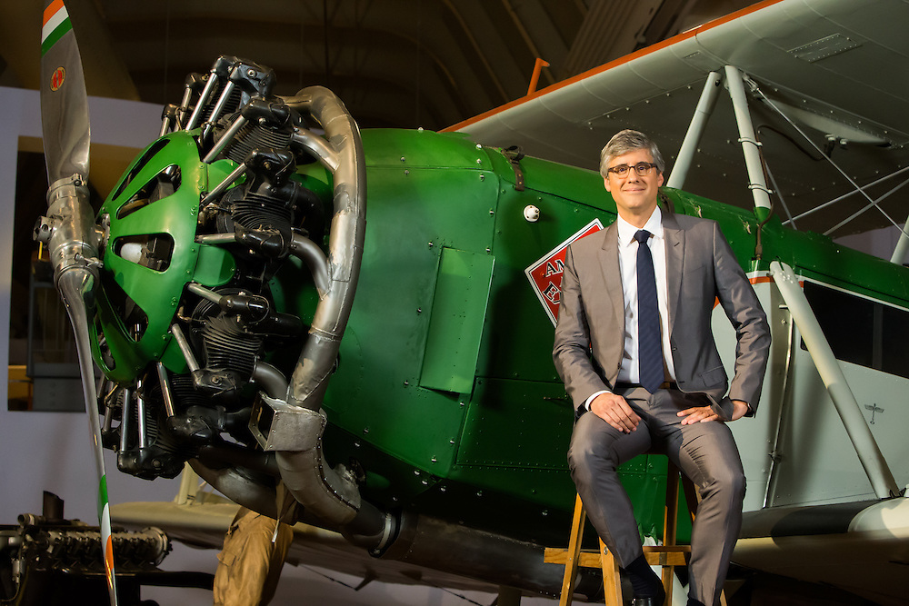 Mo Rocca posing next to a plane during the filming of The Henry Ford's Innovation Nation on CBS Saturday morning.  Photographed by Kristina Sikora for The Henry Ford