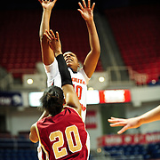 South Alabama's forward, Ronneka Robertson (10), shoots over Denver's forward, Maiya Michel (20) in the first half of play in Mobile, AL. Denver leads South Alabama 21-19 at halftime...
