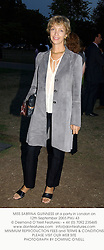 MISS SABRINA GUINNESS at a party in London on 12th September 2003.PMJ 43