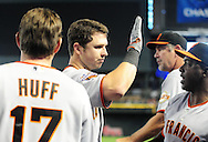 Apr. 17 2011; Phoenix, AZ, USA; San Francisco Giants batter Buster Posey (28) is congratulated by teammates after hitting a two run home run during the sixth inning against the Arizona Diamondbacks at Chase Field. Mandatory Credit: Jennifer Stewart-US PRESSWIRE..