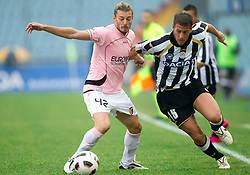 Federico Balzaretti of Palermo vs Denis German Gustavo of Udinese during football match between Udinese Calcio and Palermo in 8th Round of Italian Seria A league, on October 24, 2010 at Stadium Friuli, Udine, Italy.  Udinese defeated Palermo 2 - 1. (Photo By Vid Ponikvar / Sportida.com)