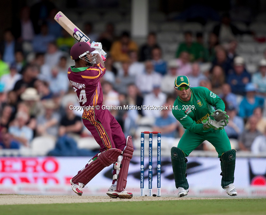 Lendl Simmons past wicket keeper Mark Boucher during the ICC World Twenty20 Cup match between South Africa and West Indies at the Oval. Photo © Graham Morris (Tel: +44(0)20 8969 4192 Email: sales@cricketpix.com)
