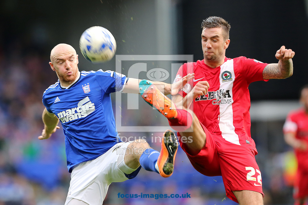 Conor Sammon of Ipswich Town and Shane Duffy of Blackburn Rovers battle during the Sky Bet Championship match at Portman Road, Ipswich<br /> Picture by Richard Calver/Focus Images Ltd +447792 981244<br /> 18/10/2014