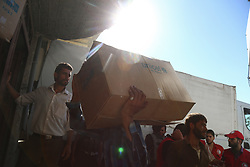 July 30, 2017 - Ghouta, Damascus, Syria - The Syrian Arab Red Crescent is unloading UN convoys, food aid In the village of Nashabiya, Marj area, July 30, 2017. (Credit Image: © Samer Bouidani/NurPhoto via ZUMA Press)