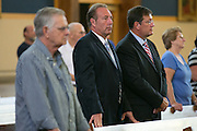 State Senator Joe Robach listens during a mass honoring local first responders at Our Mother of Sorrows Church in Greece on Wednesday, September 9, 2015.