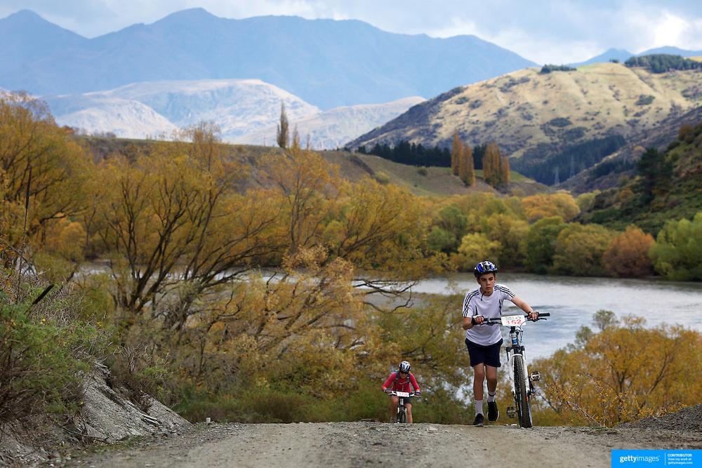 Jamie Silvester pushes his bike up a hill during the New World Tour de Wakatipu bike race on Saturday. Six hundred and ninety people entered the bike race which featured an  exclusive course with breathtaking views from Millbrook Resort in Arrowtown to Chard Farm along the Kawarau River, via the trails and tracks of the Wakatipu basin with distances of 36 kilometres fun riding for recreational bikers and 45 kilometres for elite and sport racers. The event was part of the inaugural Queenstown Bike Festival, which took place from 16th-25th April. The event hopes to highlight Queenstown's growing profile as one of the three leading biking centres in the world. Queenstown, Central Otago, New Zealand. 23rd April 2011. Photo Tim Clayton..