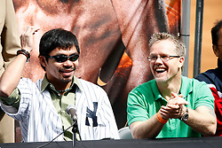 September 10, 2009; Bronx, NY; USA; Manny Pacquiao (l) and Freddie Roach (r) share a laugh at the press conference at Yankee Stadium announcing Pacquiao's fight against Miguel Cotto on November 14, 2009.  The two will meet at the MGM Grand Garden Arena in Las Vegas, NV.