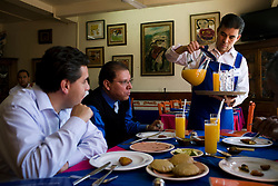 A waiter pours mandarin juice for customers at El Bajio, a well known restaurant in Mexico City for traditional mexican cuisine.