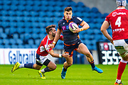 Damien Hoyland (#15) of Edinburgh Rugby is tackled by Paul Abadie (#9 of SU Agen Rugby during the European Rugby Challenge Cup match between Edinburgh Rugby and SU Agen at BT Murrayfield, Edinburgh, Scotland on 18 January 2020.