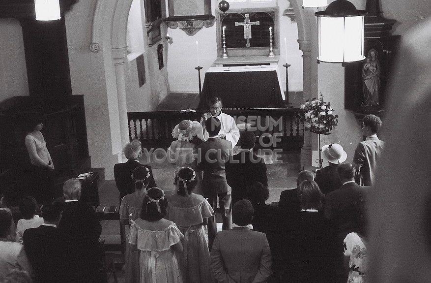 Teenagers getting married in church, London, UK, 1983