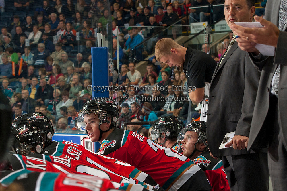 KELOWNA, CANADA - SEPTEMBER 21:  Joe Gatenby #28 of the Kelowna Rockets watches the play from the bench opposite the Kamloops Blazers at the Kelowna Rockets on September 21, 2013 at Prospera Place in Kelowna, British Columbia, Canada (Photo by Marissa Baecker/Shoot the Breeze) *** Local Caption ***
