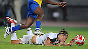 8/21/08 11:28:06 PM -- The 2008 Beijing Summer Olympics -- Beijing, China<br />  -- Team USA's Carli Lloyd goes down to the turf by Brazil's Formiga during their Women's Soccer Gold Medal Game Thrusday August 21, 2008. -- <br /> <br /> <br /> Photo by Jeff Swinger, USA TODAY Staff